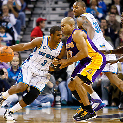December 29, 2010; New Orleans, LA, USA; New Orleans Hornets point guard Chris Paul (3) drives past Los Angeles Lakers point guard Derek Fisher (2) during the second quarter at the New Orleans Arena.   Mandatory Credit: Derick E. Hingle