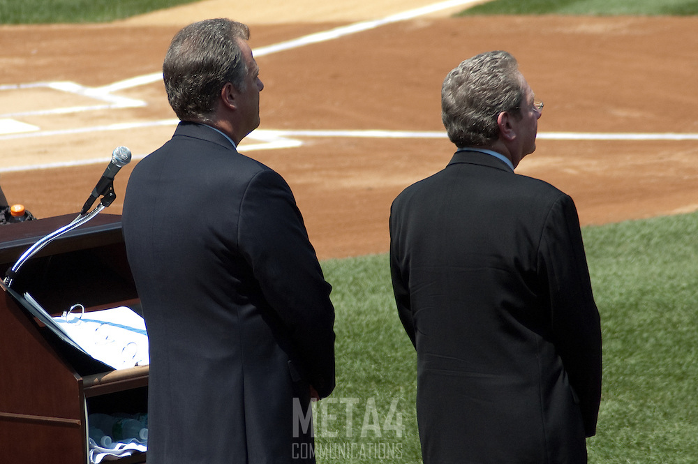Veteran Yankees' broadcasters Michael Kay and John Sterling stand ready to begin the ceremony.