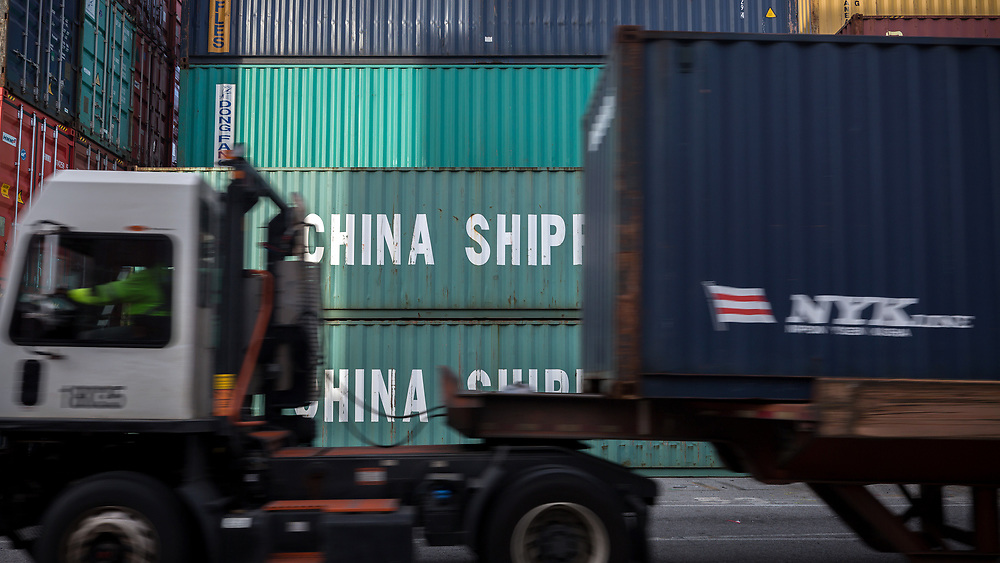 HOLD FOR JENNY KANE** In this July, 5, 2018 photo, a jockey truck passes a stack of 40-foot China Shipping containers, Thursday, July 5, 2018, at the Port of Savannah in Savannah, Ga. The U.S. hiked tariffs on Chinese imports Friday and Beijing said it immediately retaliated in a dispute between the world's two biggest economies. (AP Photo/Stephen B. Morton)