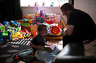 Damien (39) reads to Lucas (5 ) at home in Shefield UK Tuesday, Aug. 12, 2014The D'Arby family is involved in the FAST  (Families and Schools Together) program which encourages parents to read to their children at home.(Elizabeth Dalziel for Save the Children )