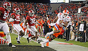 Clemson Tigers quarterback Deshaun Watson (4) scores on a keeper as Alabama Crimson Tide linebacker Rashaan Evans (32) pursues in the second quarter of the National Championship game at Raymond James Stadium in Tampa, Monday, January 9, 2017.
