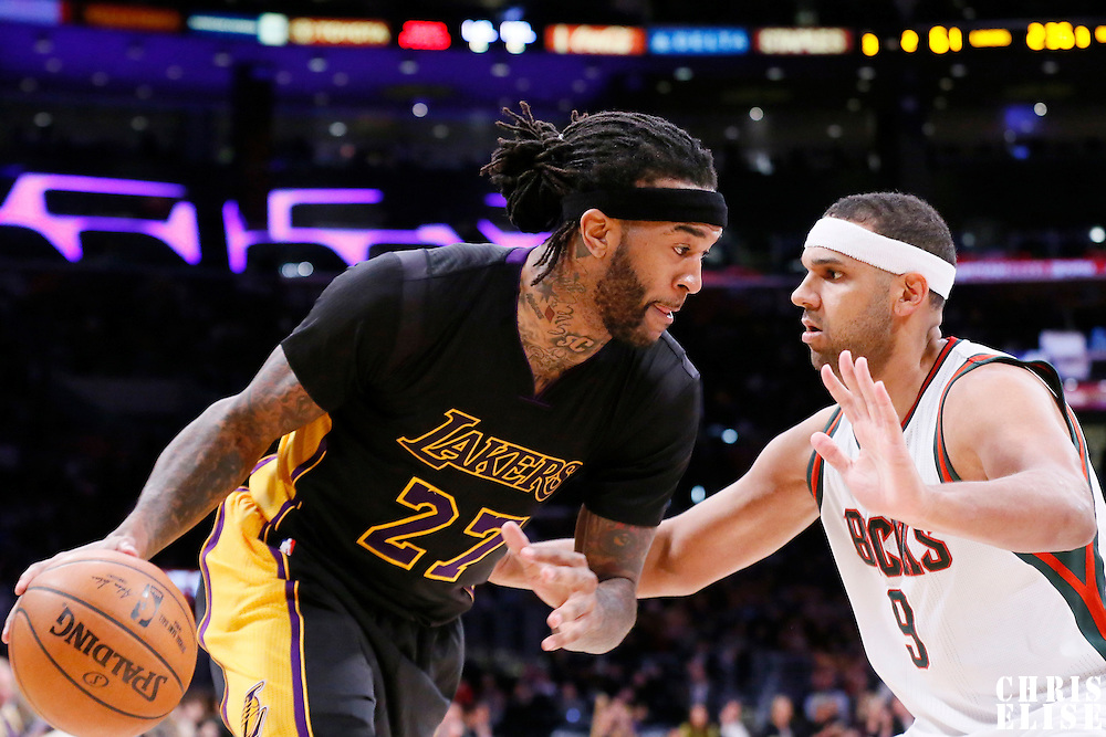27 February 2015: Los Angeles Lakers center Jordan Hill (27) drives past Milwaukee Bucks guard Jared Dudley (9) during the Los Angeles Lakers 101-93 victory over the Milwaukee Bucks, at the Staples Center, Los Angeles, California, USA.
