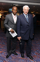 Left to right, footballer FRANK SINCLAIR and football manager SIR BOBBY ROBSON  at a sales event for the exclusive Chelsea Bridge Wharf in aid of CLIC Sargeant cancer charity held at Stamford Bridge football stadium, Chelsea, London on 7th February 2006.<br />