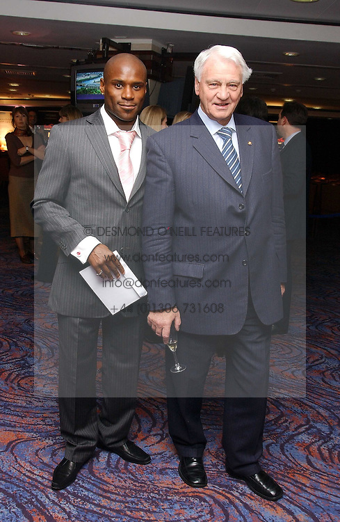 Left to right, footballer FRANK SINCLAIR and football manager SIR BOBBY ROBSON  at a sales event for the exclusive Chelsea Bridge Wharf in aid of CLIC Sargeant cancer charity held at Stamford Bridge football stadium, Chelsea, London on 7th February 2006.<br /><br />NON EXCLUSIVE - WORLD RIGHTS