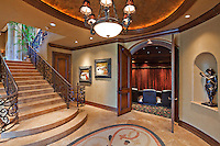 Hallway with stairway and open door in luxury mansion
