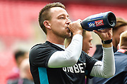 "Aston Villa assistant manager John Terry drinks champagne from a bottle with ""skybet"" logo on the label during the EFL Sky Bet Championship play off final match between Aston Villa and Derby County at Wembley Stadium, London, England on 27 May 2019."