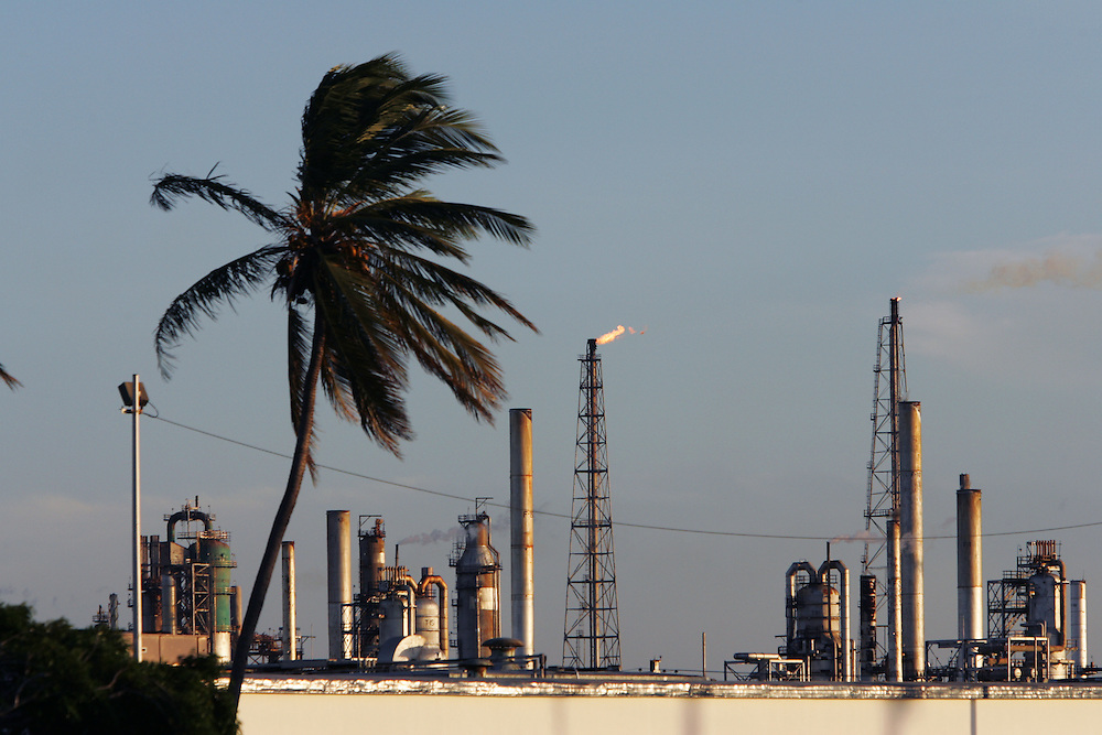 "PDVSA's oil refinery on the Paraguana Peninsula is the largest refinery in the world.  Since the removal of nearly 18,000 workers after an oil strike in Venezuela in 2002, PDVSA, the state run oil company has gone through drastic changes.  Struggling to replace the dismissed workers and return production to pre-strike quantities, PDVSA has also undertaken the financing and coordination of huge social programs.  PDVSA has invested billions of dollars in various education, food, medicine and infrastructure projects, calling itself the ""new"" PDVSA."