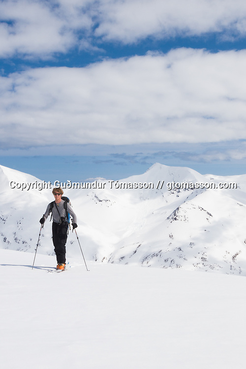 Skiers ascending mt. Darri 748m. Hvalvatnsfjörður, Iceland.
