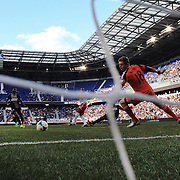 Thierry Henry, New York Red Bulls, scores the winning goal as his shot beats goalkeeper Zac MacMath during the New York Red Bulls V Philadelphia Union, Major League Soccer regular season match at Red Bull Arena, Harrison, New Jersey. USA. 30th March 2013. Photo Tim Clayton