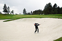 Coeur d'Alene High's Stephen Roller hits a shot out of the bunker on the first hole Thursday during the Coeur d'Alene Resort Shootout.