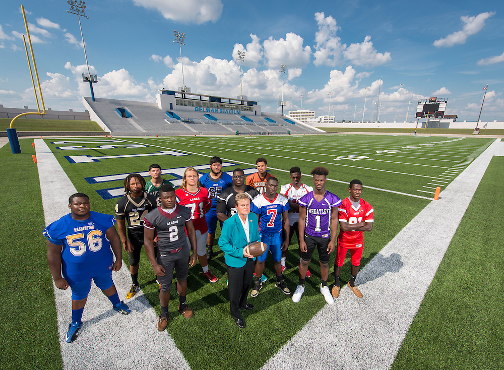 Marmion Dambrino poses for a photograph with student athletes at Delmar Stadium, September 24, 2015.