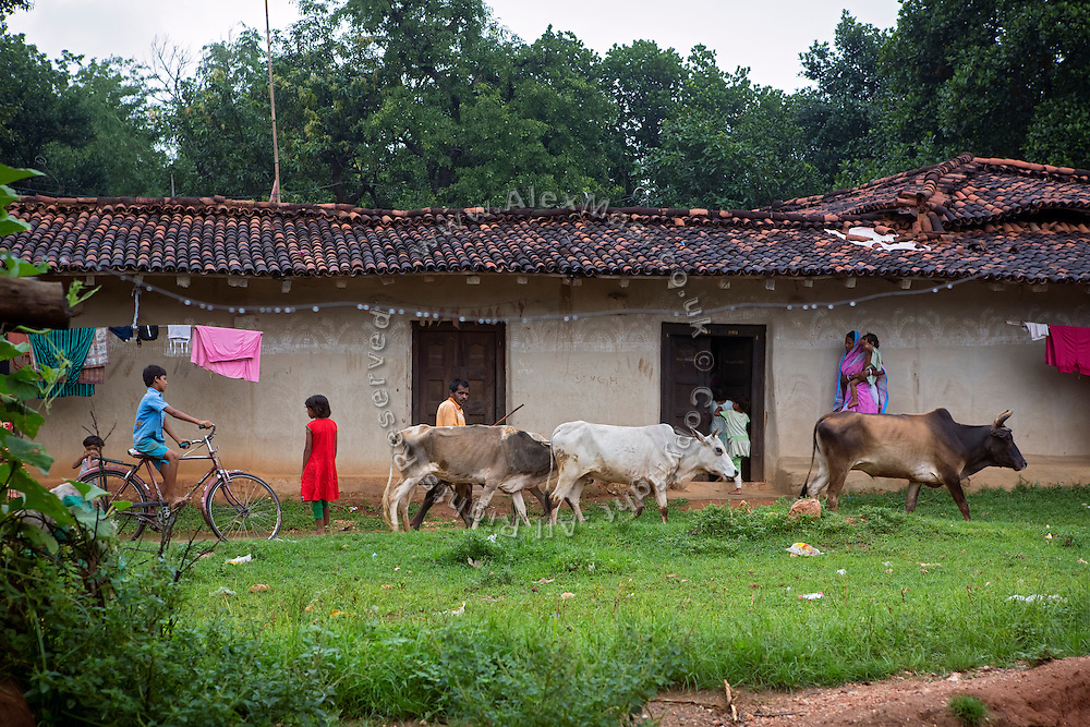 People living in Algunda village, pop. 1000, Giridih District, rural Jharkhand, India, are walking past the home of Tabasum Khatun, 14, one of the local girls trained with Karate skills by Unicef.