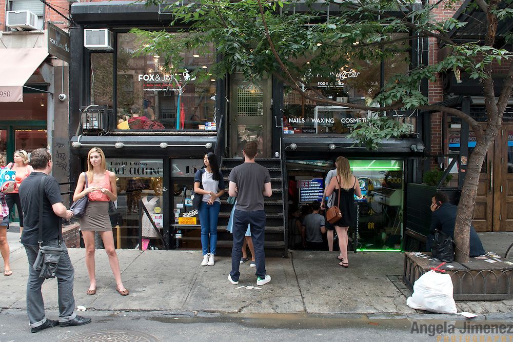 A lunch crowd waits for tables outside of Chef Danny Bowien's restaurant, Mission Chinese, at its New York City location on the Lower East Side of Manhattan on Tuesday, July 31, 2012 in New York, NY..
