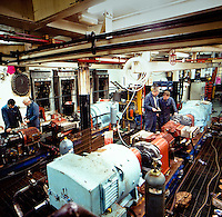 Engineers work in the engine room aboard on of J.Marr survey ships in the mid 1980's