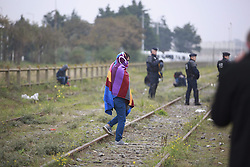 October 24, 2016 - Calais, France - Evacuation of refugee camp The Jungle in Calais, France. 1200 French police surrounded the camp and its 7000 inhabitants. The refugees will be sent on to 300 different refugee centres in France where they can search asylum or be sent back home to their origins. 2016-10-24..(c) HANSSON KRISTER  / Aftonbladet / IBL Bildbyr√•....* * * EXPRESSEN OUT * * *....AFTONBLADET / 3950....Flyktingl√§gret Djungeln i Calais evakueras (Credit Image: © Aftonbladet/IBL via ZUMA Wire)