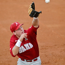 June 05, 2011; Tallahassee, FL, USA; Alabama Crimson Tide third baseman Brett Booth  makes a play on the ball against the Florida State Seminoles during the first inning of the Tallahassee regional of the 2011 NCAA baseball tournament at Dick Howser Stadium. Mandatory Credit: Derick E. Hingle