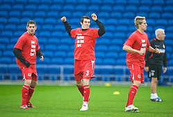 CARDIFF, WALES - Saturday, November 14, 2009: Wales' Gareth Bale warms-up wearing a 'Show Racism the Red Card' shirt before the international friendly match against Scotland at the Cardiff City Stadium. (Pic by David Rawcliffe/Propaganda)