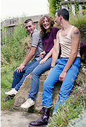 Gavin, Lucy and Symond sat in garden at Hawthorne Road, High Wycombe, UK, 1980s.