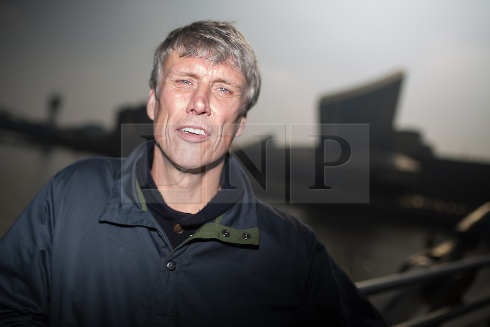 © Licensed to London News Pictures . 19/03/2015 . Salford Quays , UK . MARK BERRY ( Bez ) at Salford Quays . Black Grape photocall at The Green , Salford Quays , Greater Manchester . Black Grape are reforming for a Madchester charity gig along with other local bands , to raise awareness for Bez's Reality Party and anti-fracking . Photo credit : Joel Goodman/LNP