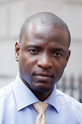 © Licensed to London News Pictures. 05/07/2013. London, UK. Duwayne Brooks, friend of murder victim Stephen Lawrence, is on Whitehall in London today (05/07/2013) after meeting with British Deputy Prime Minister Nick Clegg, over allegations that the Metropolitan Police Service bugged meetings between themselves, Brooks and his lawyers in an effort to smear the Lawrence family and their friends. Photo credit: Matt Cetti-Roberts/LNP