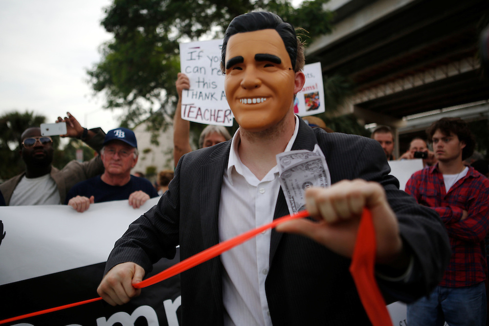 "Protesters act out theatrical scenes about their opinion of the politics of GOP Presidential candidate Mitt Romney during the Florida American Federation of Labor and Congress of Industrial Organizations (AFL-CIO) during the 2012 Republican National Convention on August 29, 2012 in Tampa, Fla. Santilli said he was ""union made,"" his mother and father were both union workers in Pittsburgh. He's continued the tradition throughout his life as a steel worker and letter carrier."