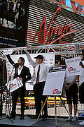 Kevin Federline, (left)  husband of the famous singer Britney Spears, is signing a petition in collaboration with Virgin, during a Virgin Mobile promotion event at Time Square, New York, on Wednesday, June 21, 2006. The petition against the abolition of the Penny coin, sponsored by Virgin Mobile, will be then sent over to lawyers in Washington. After this extraordinary event, Virgin Mobile will allow customers to buy 1000 text messages a month for only $9.99, just one humble penny per text.  **ITALY OUT**