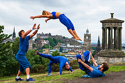 Edinburgh, Scotland, UK; 3 August, 2018. Acrobatic troupe Barely Methodical Troupe display their talents on Calton Hill in Edinburgh at the opening of The Fringe `Festival.