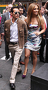 """Marc Anthony and Jennifer Lopez appear to unveil her """"Be Extraordinary"""" Poster in Times Square New York City on June 10, 2010."""