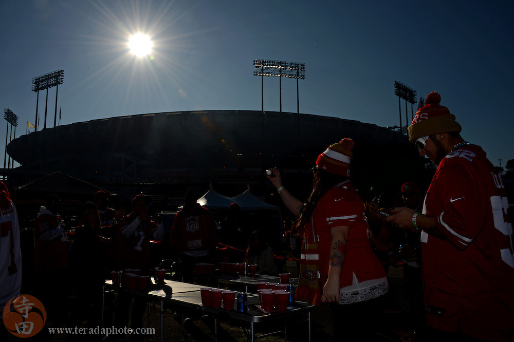 December 1, 2013; San Francisco, CA, USA; San Francisco 49ers fan Melissa Nino, from Tulare, Calif., plays beer pong before the game against the St. Louis Rams at Candlestick Park.