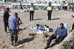 © Licensed to London News Pictures. 25/05/2020. Brighton, UK. Police patrol the beach as crowds flock to Brighton as the Bank Holiday weather brings high temperatures and sunshine. The government has announced a series of measures to slowly ease lockdown, which was introduced to fight the spread of the COVID-19 strain of coronavirus. Photo credit: Peter Macdiarmid/LNP