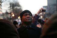 Inauguration attendees wait in freezing weather to pass a security checkpoint.
