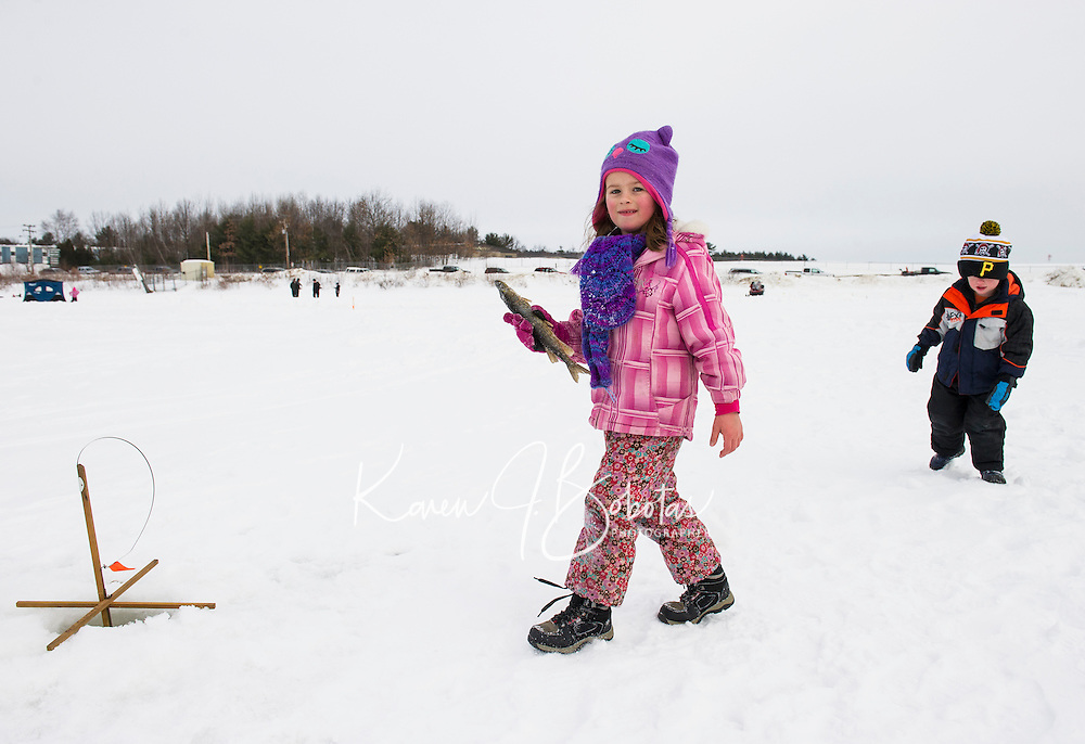 Ice Fishing on Lily Pond with the Sportmen's club in Gilford.  Karen Bobotas for the Laconia Daily Sun