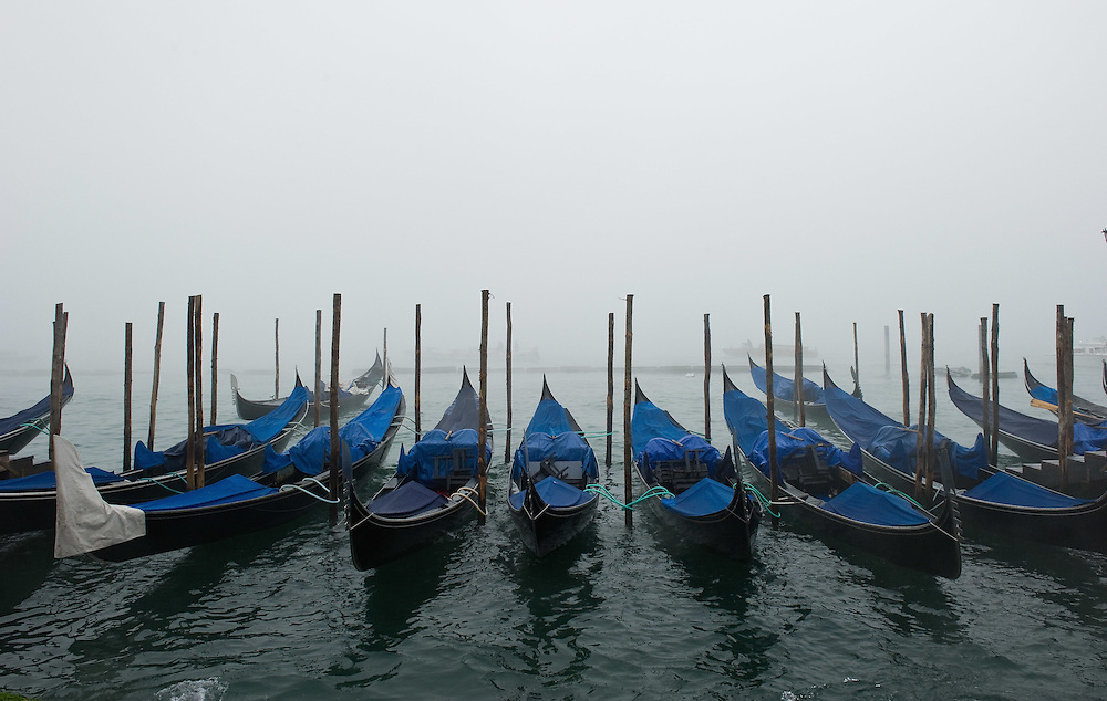 VENICE, ITALY - NOVEMBER 20: Gondolas rest in St Mark's basin as thick fog shrouds the city, on November 20, 2011 in Venice, Italy. Venice woke up this morning under a heavy blanket of fog adding to the atmosphere of the city.<br /> <br />  HOW TO LICENCE THIS PICTURE: please contact us via e-mail at sales@xianpix.com or call our offices London   +44 (0)207 1939846 for prices and terms of copyright. First Use Only ,Editorial Use Only, All repros payable, No Archiving.© MARCO SECCHI