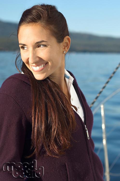 Woman on Sailboat Looking to Horizon