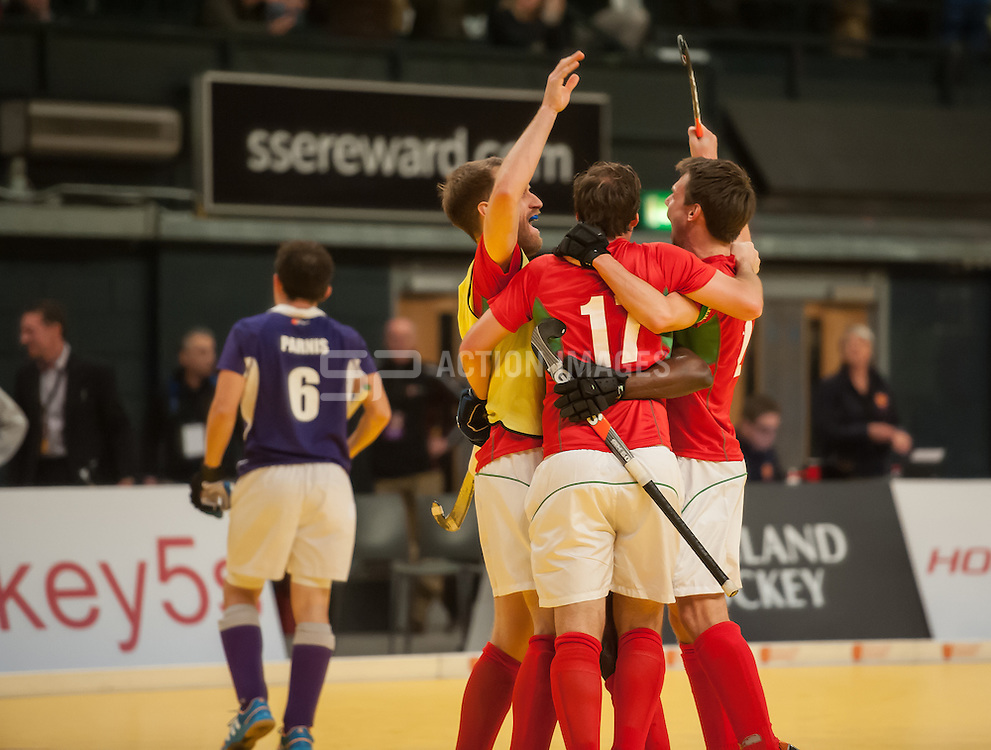 Canterbury players celebrate their win over Sevenoaks. Sevenoaks v Canterbury - Hockey 5s, SSE Arena, Wembley, London, UK on 25 January 2015. Photo: Simon Parker