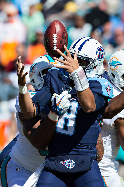 NASHVILLE, TN - OCTOBER 18:  Marcus Mariota #8 of the Tennessee Titans has the ball knocked away while trying to throw a pass during a game against the Miami Dolphins at LP Field on October 18, 2015 in Nashville, Tennessee.  The Dolphins defeated the Titans 38-10.  (Photo by Wesley Hitt/Getty Images) *** Local Caption *** Marcus Mariota