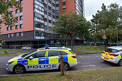 © Licensed to London News Pictures. 25/09/2019. Headington, UK. A police vehicle sits outside Foresters Tower after a two die. Thames Valley Police were called to Foresters Tower in Wood Farm Road, Headington, at 21:18 BST on 24th September 2019 to reports that a man had fallen from an upper floor of Foresters Tower. The man died at the scene. <br /> Following a search of flats at Foresters Tower, a woman was located on the fourth floor with severe neck injuries and was pronounced dead at the scene.. Photo credit: Peter Manning/LNP