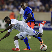 Juan Garcia, Honduras, (right), is tackled by Yves Hadley Desmarets, Haiti, during the Haiti V Honduras CONCACAF Gold Cup group B football match at Red Bull Arena, Harrison, New Jersey. USA. 8th July 2013. Photo Tim Clayton