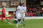 Ade Azeez of AFC Wimbledon celebrates with Dannie Bulman of AFC Wimbledon after his opener during the Sky Bet League 2 match between York City and AFC Wimbledon at Bootham Crescent, York, England on 24 October 2015. Photo by Stuart Butcher.