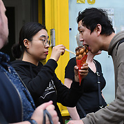 Everyday people queue for Bubblewrap Waffle in Chinatown London, UK