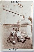 female friends sitting in front of a large mansion 1925 in Denmark Klampenborg