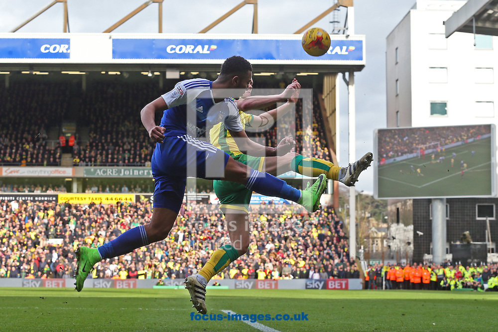 Myles Kenlock of Ipswich Town clears the ball ahead of Jonny Howson of Norwich during the Sky Bet Championship match at Carrow Road, Norwich<br /> Picture by Paul Chesterton/Focus Images Ltd +44 7904 640267<br /> 26/02/2017