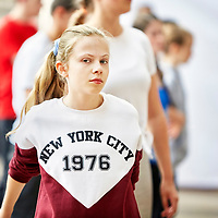A photograph of a girl warming up during the rehearsal of a musical theatre performance.