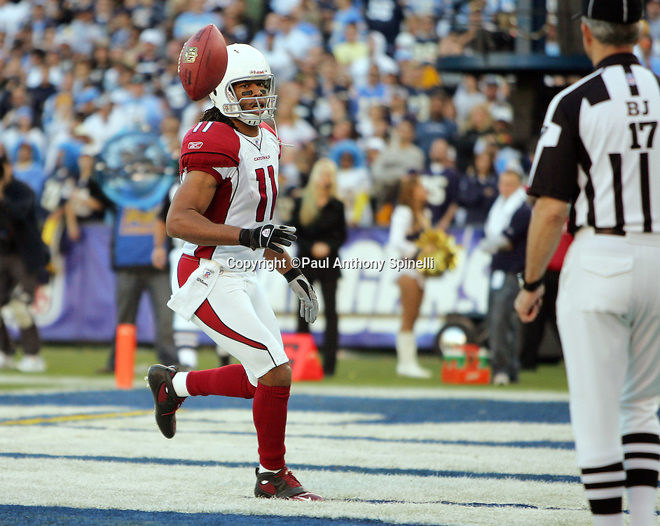 SAN DIEGO - DECEMBER 31:  Wide receiver Larry Fitzgerald #11 of the Arizona Cardinals flips the football to an official after scoring a touchdown to narrow the lead to ten points (10-27) against the San Diego Chargers at Qualcomm Stadium on December 31, 2006 in San Diego, California. The Chargers defeated the Cardinals 27-20 to secure the number one seed in the AFC playoffs. ©Paul Anthony Spinelli *** Local Caption *** Larry Fitzgerald