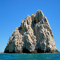 El Cerro Blanco Rock Formation in Cabo San Lucas, Mexico<br /> Several rocky pinnacles protrude from the water around Land&rsquo;s End with descriptive names like The Chimney, Pelican Rock and Neptune&rsquo;s Finger. At the southernmost tip of the 800 mile Baja California Peninsula are Los Frailes or The Friars. This name was bestowed on the rock formations by the author John Steinbeck because they look like hooded monks. The largest of the three is this granite outcrop called El Cerro Blanco which means white hill.