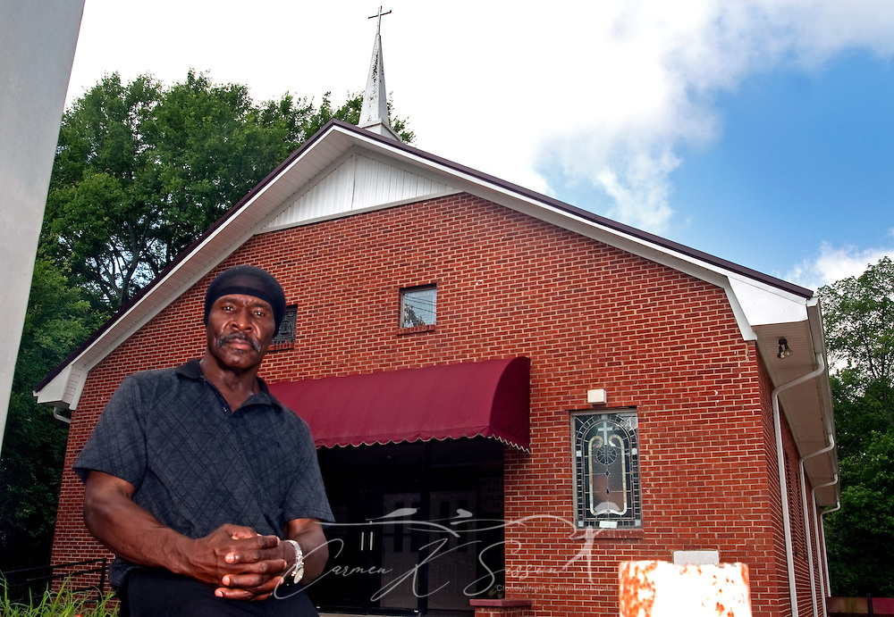 Johnny Holley Jr. poses in front of Beard Chapel AME Zion Church in Tuscaloosa, Ala. May 8, 2009. Holley, 63, was released from prison in April after serving 29 years of a life without parole sentence for armed robbery in the first degree. Holley, who was sentenced under the three strikes law for stealing a toolbox in 1980, was allowed to go free following the Alabama Legislature's 2000 decision to ease mandatory sentences for non-violent, repeat offenders. (Carmen K. Sisson/Cloudybright)