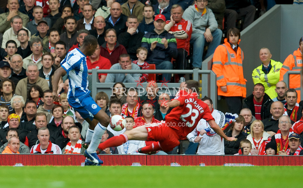 LIVERPOOL, ENGLAND - Saturday, October 18, 2008: Liverpool's Jamie Carragher makes a crucial tackle during the Premiership match against Wigan Athletic at Anfield. (Photo by David Rawcliffe/Propaganda)