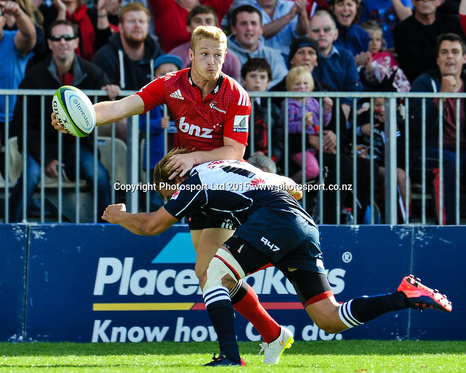 Johnny McNicholl of the Crusaders pasess in the tackle of Andries Coetzee of the Lions during the Super Rugby match: Crusaders v Lions at AMI Stadium, Christchurch, New Zealand, 14 March 2015. Copyright Photo: John Davidson / www.Photosport.co.nz