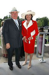 ANTHONY & ANTOINETTE OPPENHEIMER at the King George VI and The Queen Elizabeth Diamond Stakes sponsored by De Beers for the 35th year held at Ascot Racecourse, Berkshire on July 29th 2006.    De Beers hosted a lunch before the races for about 250 people.<br />