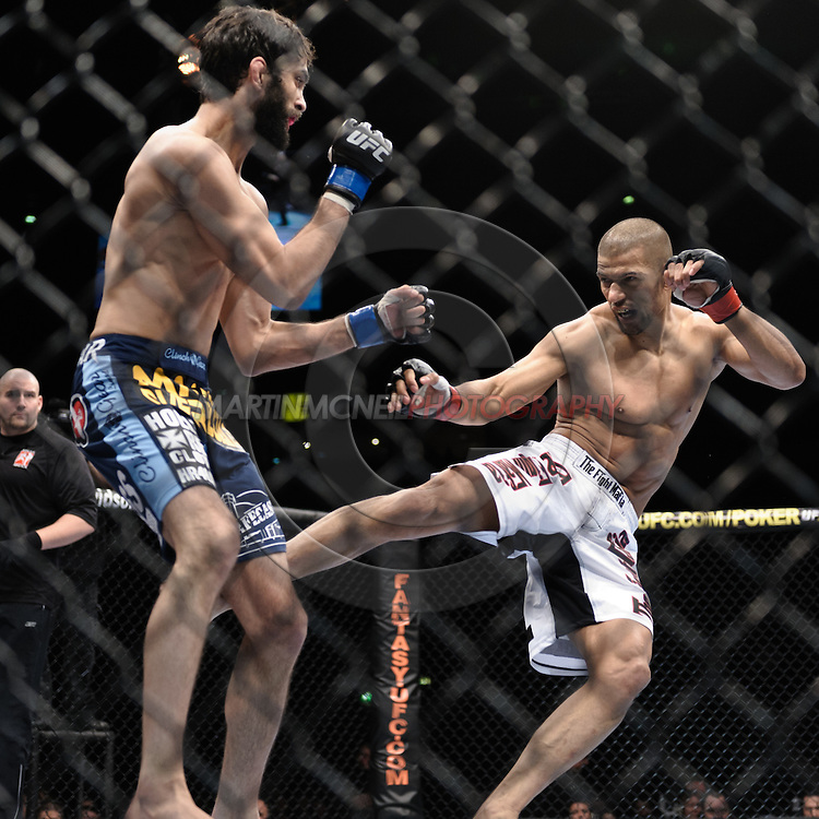 "MANCHESTER, ENGLAND, NOVEMBER 14, 2009: Rolando Delgado (left) and Andre Winner during ""UFC 105: Couture vs. Vera"" inside the MEN Arena in Manchester, United Kingdom."